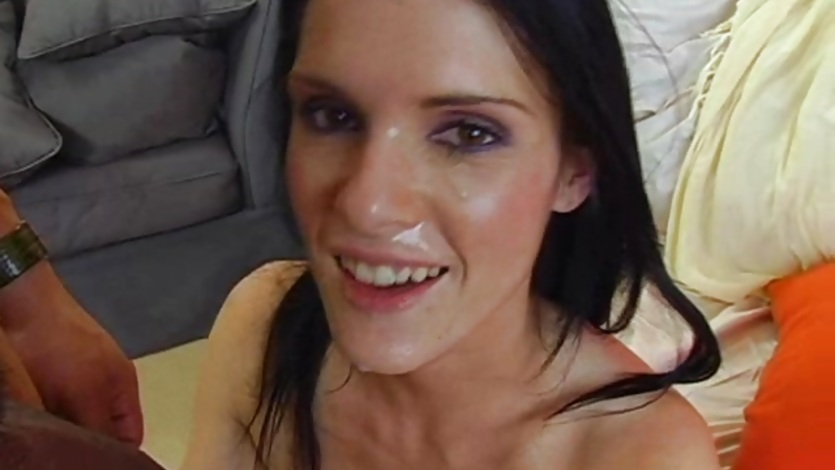 Sexy babe Jennifer Dark gets a shot of hot gooey cum sprayed in her face