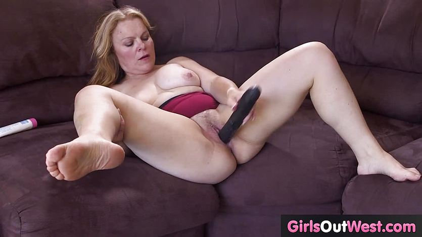 Busty mature lady masturbates with big black cock