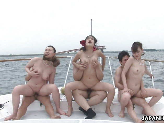 Group banging on a boat with beautiful busty Asian babes